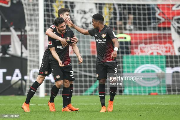 Kevin Volland of Bayer Leverkusen celebrates with his teammates after scoring his teams second goal to make it 21 during the Bundesliga match between...