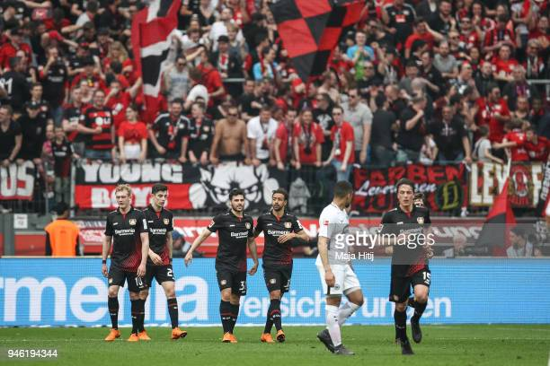 Kevin Volland of Bayer Leverkusen celebrates with his teammates after scoring his teams thirth goal to make it 31 during the Bundesliga match between...