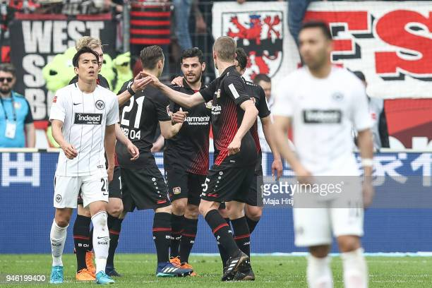 Kevin Volland of Bayer Leverkusen celebrates with his teammates after scoring his teams forth goal to make it 41 during the Bundesliga match between...