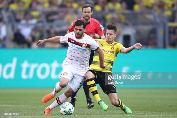 Kevin Volland of Bayer Leverkusen fights for th eball with Julian Weigl of Dortmund during the Bundesliga match between Borussia Dortmund and Bayer...