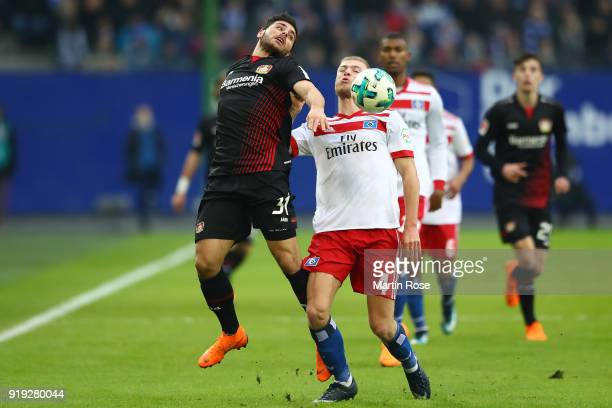 Kevin Volland of Bayer Leverkusen fights for the ball with Rick van Drongelen of Hamburg during the Bundesliga match between Hamburger SV and Bayer...