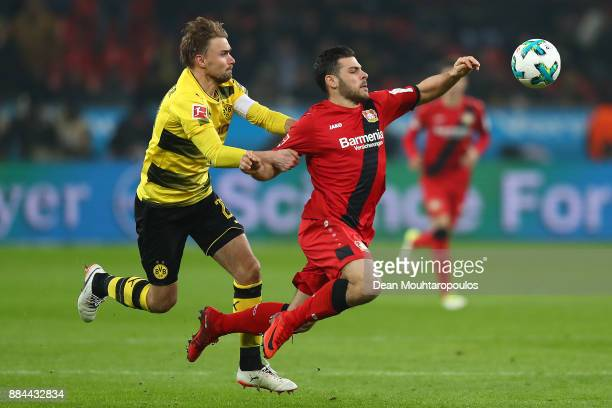 Kevin Volland of Bayer Leverkusen is fouled by Marcel Schmelzer of Dortmund during the Bundesliga match between Bayer 04 Leverkusen and Borussia...