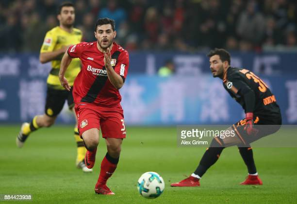 Kevin Volland of Bayer Leverkusen passes Roman Buerki of Dortmund to score a goal to make it 10 during the Bundesliga match between Bayer 04...