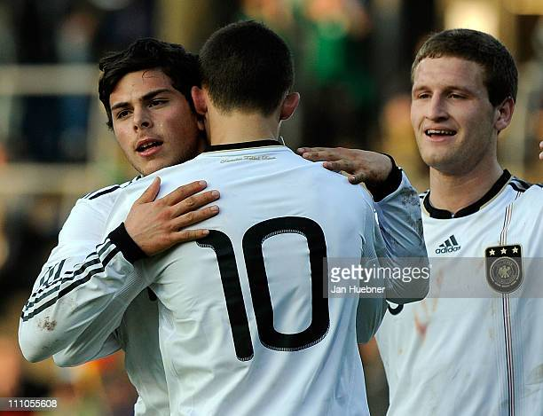 Kevin Volland of Germany celebrates the second goal with team mates Denis Thomalla and Shkodran Mustafi during the international friendly match...
