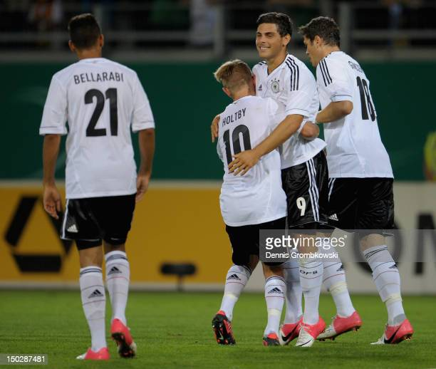 Kevin Volland of Germany celebrates with teammates after scoring his team's fifth goal during the Under 21 international friendly match between...