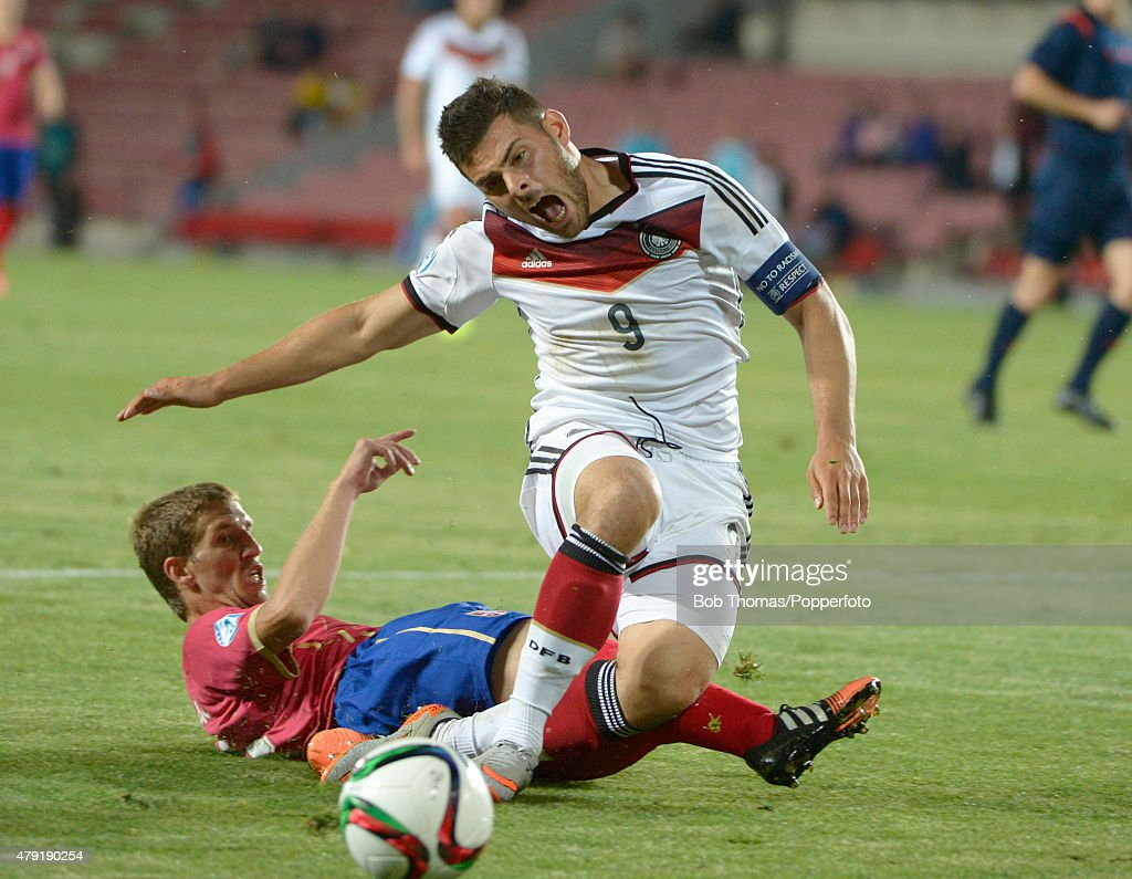 Kevin Volland of Germany is tackled by Darko Brasanac of Serbia during the UEFA European Under-21 Group A match between Germany and Serbia at Letna Stadium on June 17, 2015 in Prague, Czech Republic. The match was drawn 1-1. (Photo by Bob Thomas/Popperfoto/Getty Images).