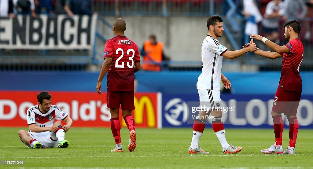 Kevin Volland of Germany shake hands with Ricardo Esgaio of Portugal after the UEFA European Under-21 semi final match Between Portugal and Germany at Ander Stadium on June 27, 2015 in Olomouc, Czech Republic.