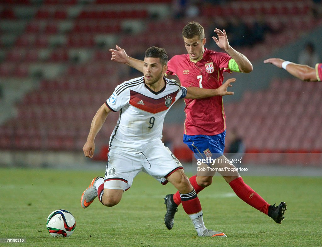 Kevin Volland of Germany with Goran Causic (right) of Serbia during the UEFA European Under-21 Group A match between Germany and Serbia at Letna Stadium on June 17, 2015 in Prague, Czech Republic. The match was drawn 1-1. (Photo by Bob Thomas/Popperfoto/Getty Images).