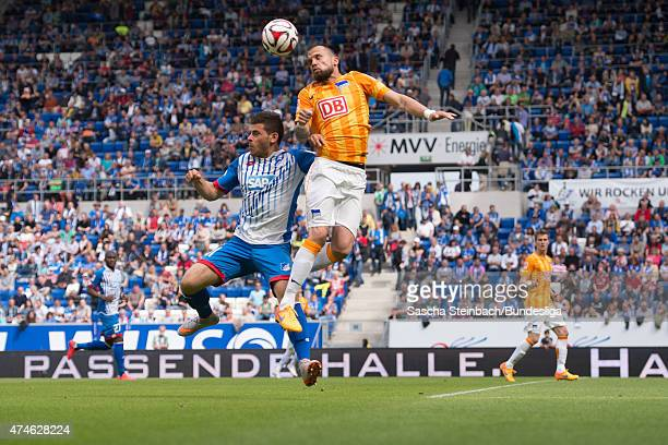 Kevin Volland of Hoffenheim and John Heitinga of Berlin battle for the ball during the Bundesliga match between 1899 Hoffenheim and Hertha BSC Berlin...