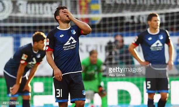 Kevin Volland of Hoffenheim and team mates react after the Bundesliga match between 1899 Hoffenheim and VfB Stuttgart at Wirsol RheinNeckarArena on...