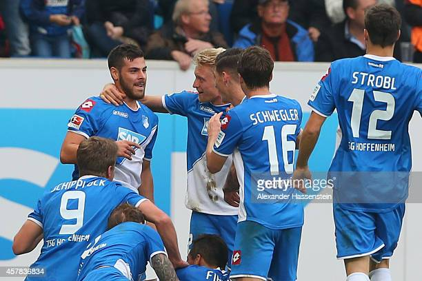 Kevin Volland of Hoffenheim celebrates scoring the opening goal with his team mates during the Bundesliga match between TSV 1899 Hoffenheim and SC...