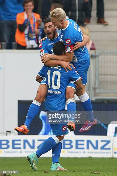 Kevin Volland of Hoffenheim celebrates scoring the opening goal with his team mate Roberto Firminio and Andreas Beck during the Bundesliga match...