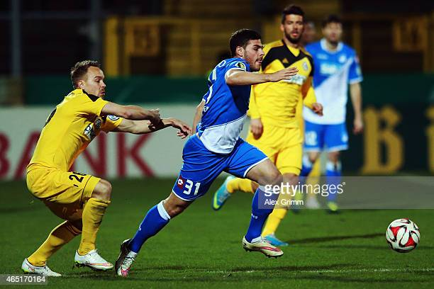 Kevin Volland of Hoffenheim eludes Arne Feick of Aalen during the DFB Cup Round of 16 match between VfR Aalen and 1899 Hoffenheim at Scholz Arena on...