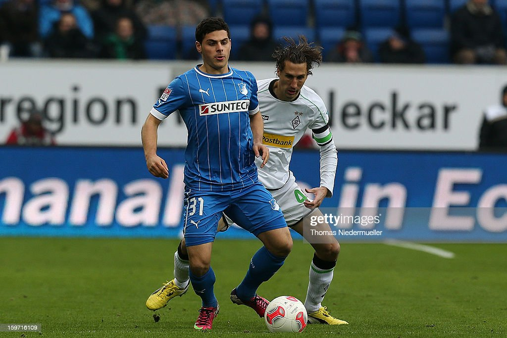 Kevin Volland (L) of Hoffenheim fights for the ball with Roel Brouwers (R) of Moenchengladbach during the Bundesliga match between TSG 1899 Hoffenheim and VfL Borussia Moenchengladbach at Rhein-Neckar-Arena on January 19, 2013 in Sinsheim, Germany.