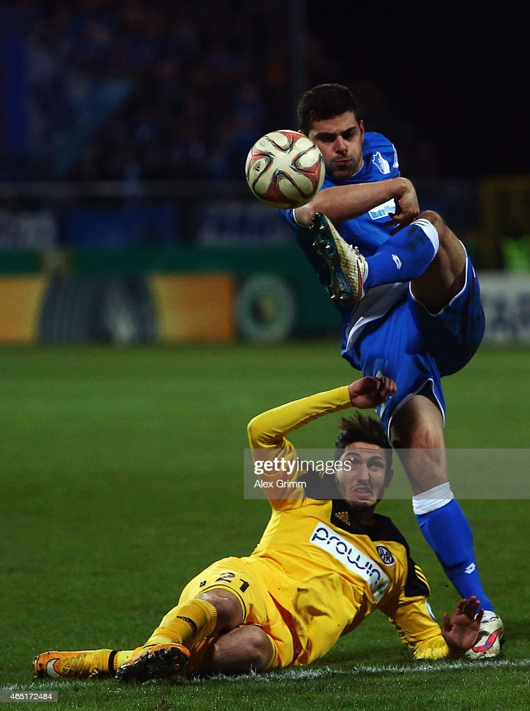 Kevin Volland (R) of Hoffenheim is challenged by Fabio Kaufmann of Aalen during the DFB Cup Round of 16 match between VfR Aalen and 1899 Hoffenheim at Scholz Arena on March 3, 2015 in Aalen, Germany.