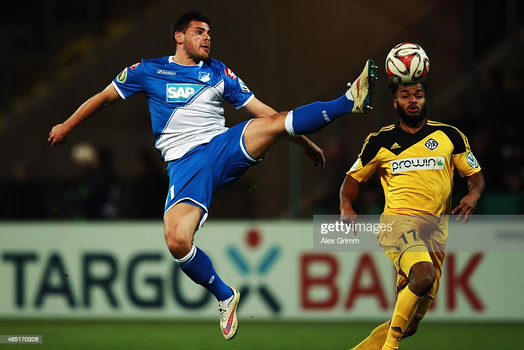 Kevin Volland (L) of Hoffenheim is challenged by Phil Ofosu-Ayeh of Aalen during the DFB Cup Round of 16 match between VfR Aalen and 1899 Hoffenheim at Scholz Arena on March 3, 2015 in Aalen, Germany.