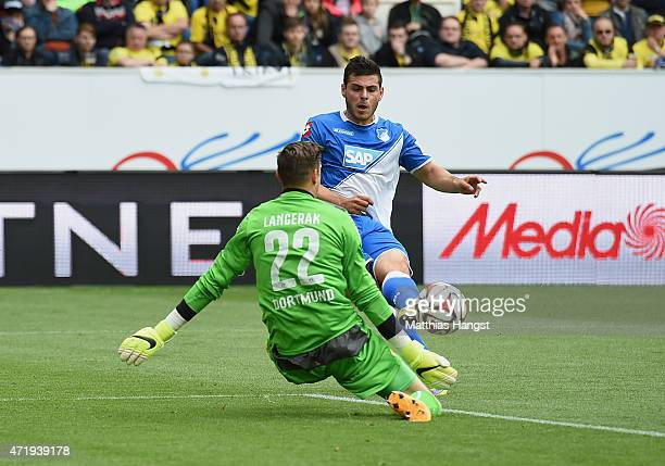 Kevin Volland of Hoffenheim scores his team's first goal past goalkeeper Mitchell Langerak of Dortmund during the Bundesliga match between 1899...