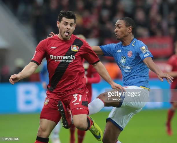 Kevin Volland of Leverkusen and Abdou Diallo of Mainz battle for the ball during the Bundesliga match between Bayer 04 Leverkusen and 1 FSV Mainz 05...