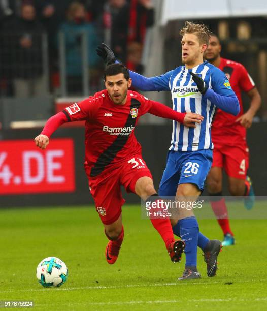 Kevin Volland of Leverkusen and Arne Maier of Berlin battle for the ball during the Bundesliga match between Bayer 04 Leverkusen and Hertha BSC at...