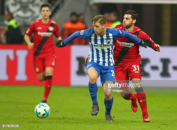 Kevin Volland of Leverkusen and Arne Maierbattle for the ball during the Bundesliga match between Bayer 04 Leverkusen and Hertha BSC at BayArena on...