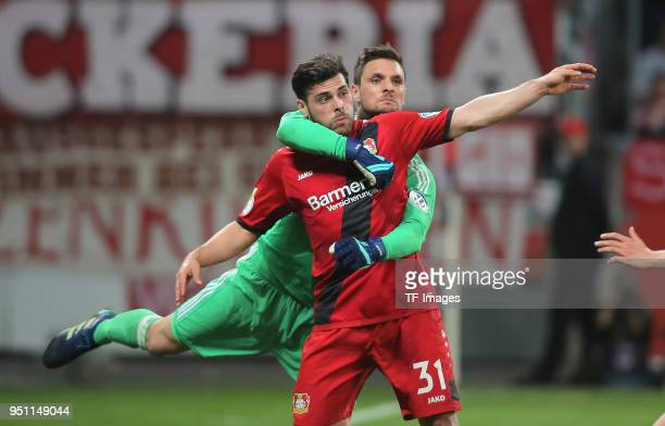 Kevin Volland of Leverkusen and Goalkeeper Sven Ulreich of Muenchen battle for the ball during the DFB Cup semi final match between Bayer 04...