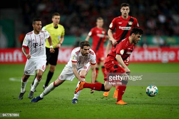 Kevin Volland of Leverkusen and Javier Martinez of Muenchen battle for the ball during the DFB Cup semi final match between Bayer 04 Leverkusen and...