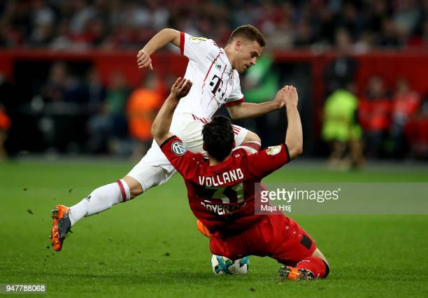 Kevin Volland of Leverkusen and Joshua Kimmich of Muenchen battle for the ball during the DFB Cup semi final match between Bayer 04 Leverkusen and...