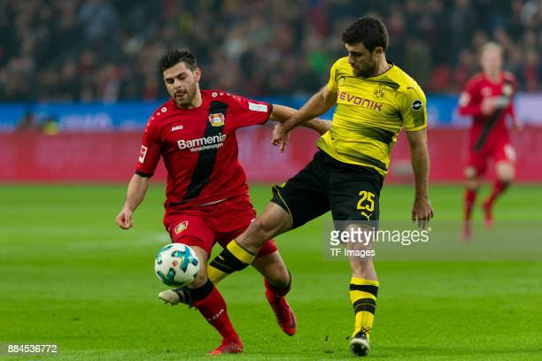 Kevin Volland of Leverkusen and Sokratis Papastathopoulos of Dortmund battle for the ball during the Bundesliga match between Bayer 04 Leverkusen and...