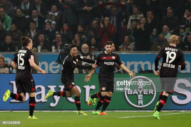 Kevin Volland of Leverkusen celebrates his team's first goal with team mates Julian Baumgartlinger Benjamin Henrichs and Julian Brandt during the...