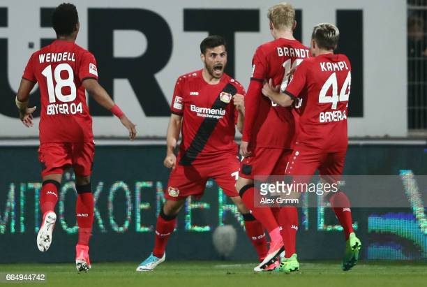 Kevin Volland of Leverkusen celebrates his team's second goal with team mates Wendell Julian Brandt and Kevin Kampl during the Bundesliga match...