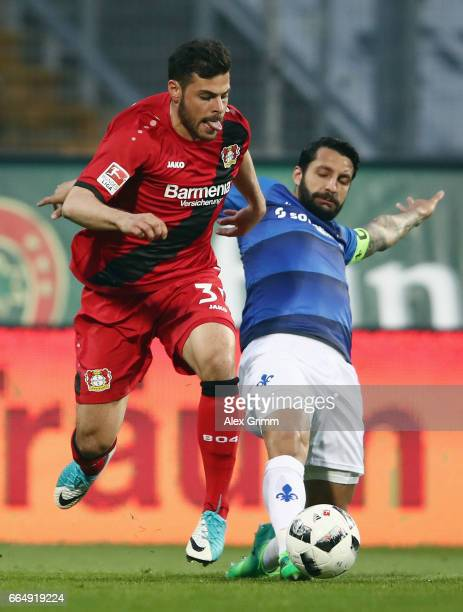 Kevin Volland of Leverkusen eludes Aytac Sulu of Darmstadt during the Bundesliga match between SV Darmstadt 98 and Bayer 04 Leverkusen at Jonathan...