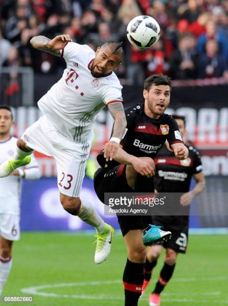 Kevin Volland of Leverkusen in action against Arturo Vidal of Munich during the Bundesliga soccer match between Bayer 04 Leverkusen and FC Bayern...
