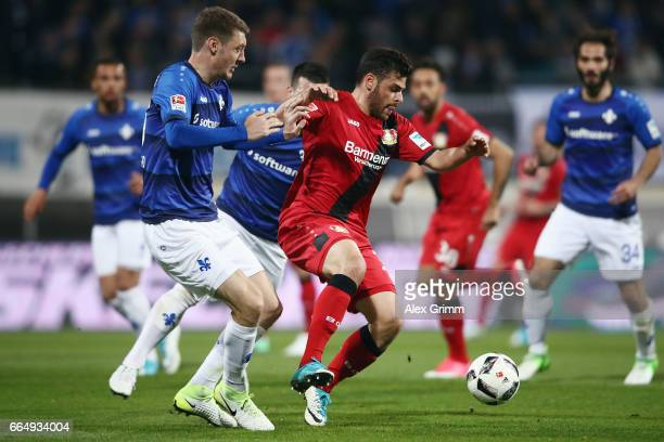 Kevin Volland of Leverkusen is challenged by Patrick Banggaard of Darmstadt during the Bundesliga match between SV Darmstadt 98 and Bayer 04...