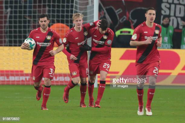 Kevin Volland of Leverkusen Julian Brandt of Leverkusen Kai Havertz of Leverkusen and Dominik Kohr of Leverkusen celebrate their team`s goal during...