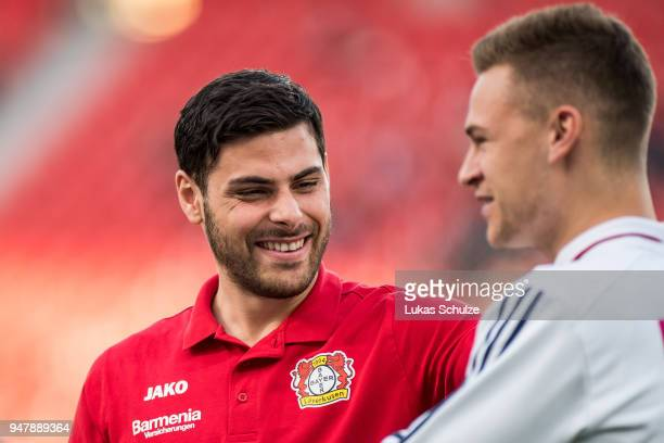 Kevin Volland of Leverkusen talks to Joshua Kimmich of Munich prior to the DFB Cup semi final match between Bayer 04 Leverkusen and Bayern Muenchen...
