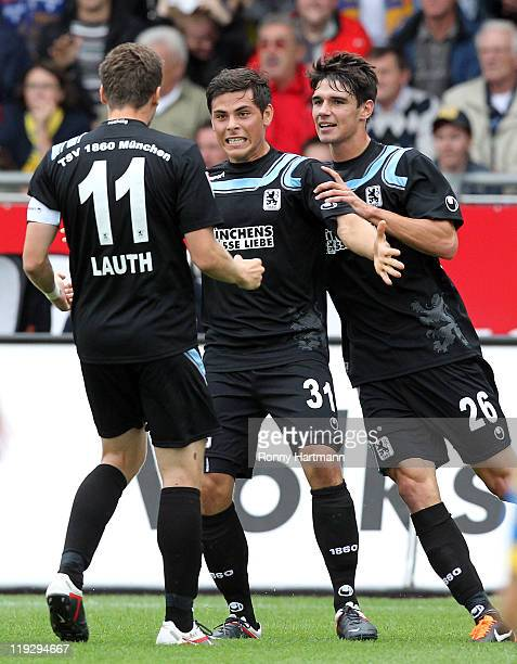 Kevin Volland of Muenchen celebrates scoring his teams first goal with Christopher Schindler and Benjamin Lauth of Muenchen during the Second...
