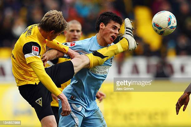 Kevin Volland of Muenchen is hit by Tobias Feisthammel of Aachen during the Second Bundesliga match between Alemannia Aachen and 1860 Muenchen at...