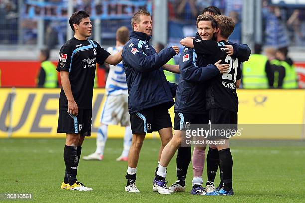 Kevin Volland Stefan Aigner Benjamin Lauth and Sandro Kaiser of Muenchen celebrate after winning 30 the Second Bundesliga match between MSV Duisburg...