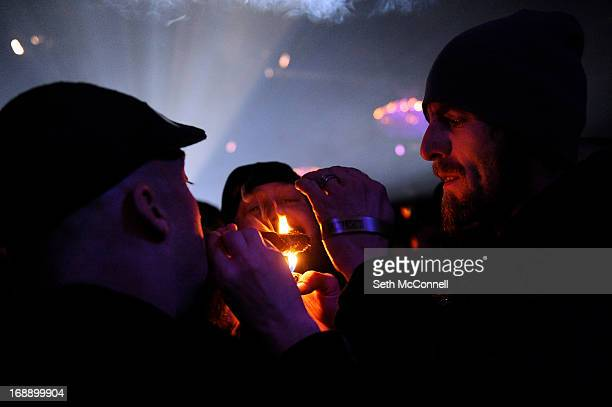 Kevin VonTesmar right tries to light a blunt that kept going out while waiting for DJ Snoopalicious aka Snoop Lion to perform a DJ set during the...
