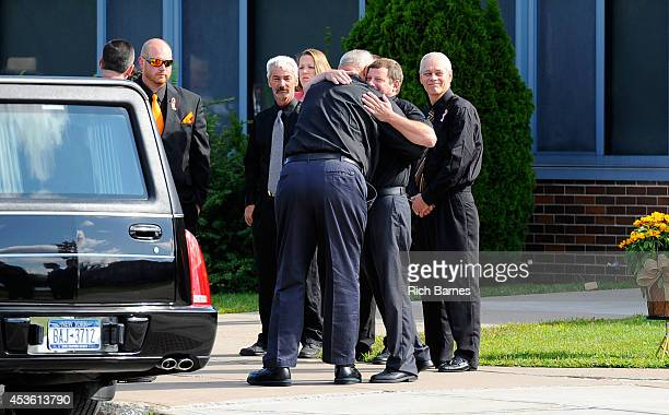 Kevin Ward Sr is consoled prior to the funeral service for his son Kevin Ward Jr at South Lewis Senior High School on August 14 2014 in Turin New...
