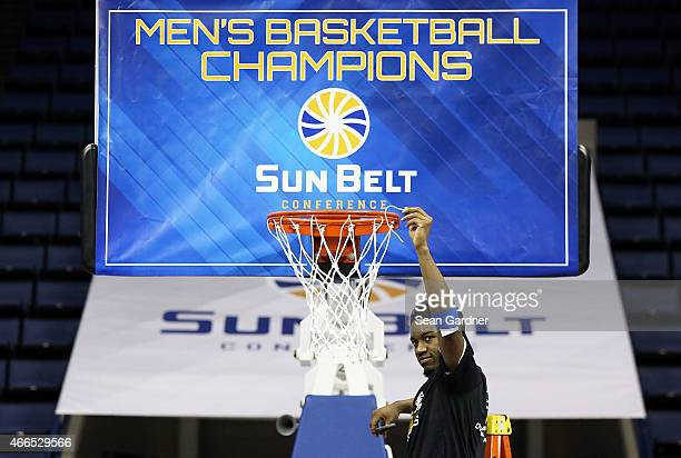 Kevin Ware of the Georgia State Panthers cuts the nets after his team defeated the Georgia Southern Eagles during the Sun Belt Conference Men's...