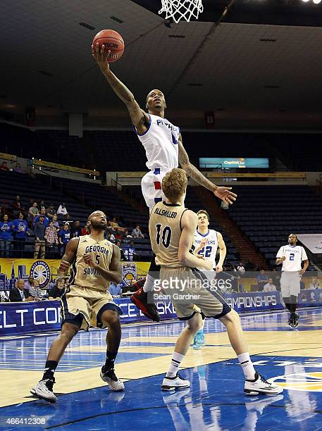 Kevin Ware of the Georgia State Panthers shoots over Jake Allsmiller of the Georgia Southern Eagles during the Sun Belt Conference Men's Championship...