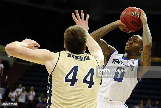 Kevin Ware of the Georgia State Panthers shoots over Trent Wiedeman of the Georgia Southern Eagles during the Sun Belt Conference Men's Championship...