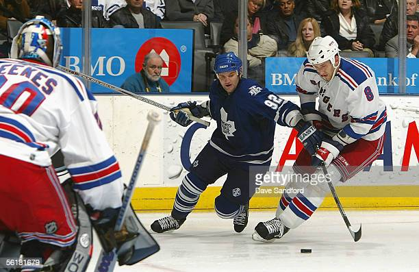 Kevin Weekes of the New York Rangers gets into position as his teammate Marek Malik and Jeff O'Neill of the Toronto Maple Leafs battle for the puck...