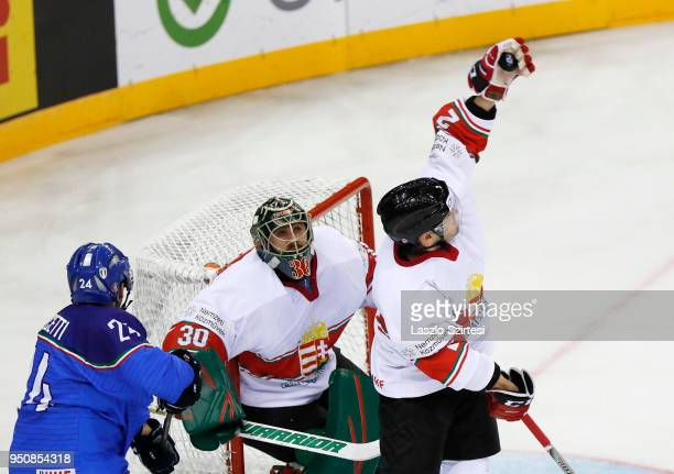 Kevin Wehrs of Hungary catches the puck next to Adam Vay of Hungary and Luca Felicetti of Italy during the 2018 IIHF Ice Hockey World Championship...