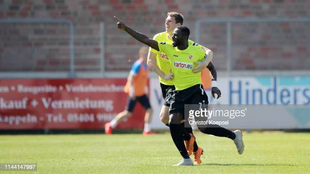 Kevin Weidlich of Cottbus celebrates the second goal with Lasse Schlueter during the 3. Liga match between VfL Sportfreunde Lotte and FC Energie...