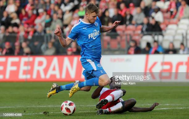 Kevin Weidlich of Cottbus challenges for the ball with Gerrit Wegkamp of Lotte during the 3 Liga match between FC Energie Cottbus and VfL...