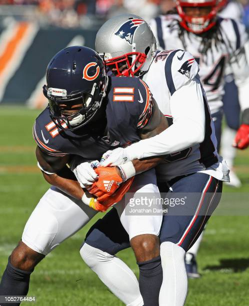 Kevin White of the Chicago Bears is tackled by Jason McCourty of the New England Patriots at Soldier Field on October 21 2018 in Chicago Illinois The...