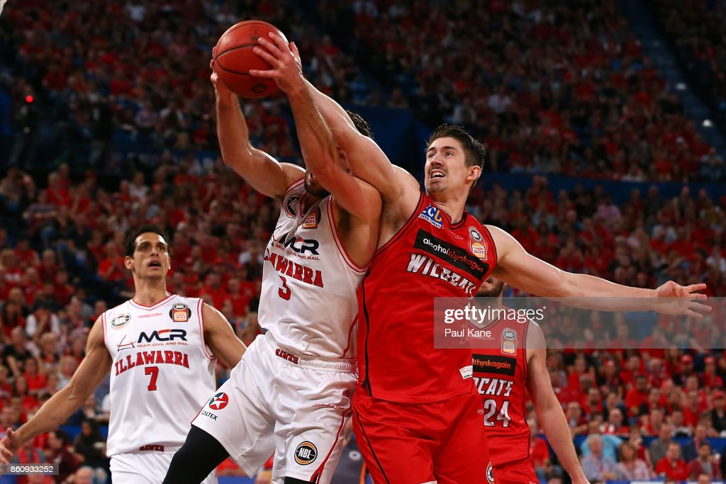 Kevin White of the Hawks and Greg Hire of the Wildcats contest a rebound during the round two NBL match between the Perth Wildcats and the Illawarra Hawks at Perth Arena on October 13, 2017 in Perth, Australia.