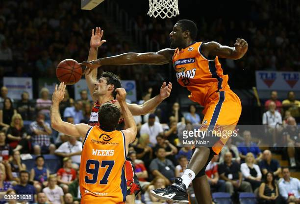 Kevin White of the Hawks is denied by the Taipans defence during the round 18 NBL match between the Illawarra Hawks and the Cairns Taipans at the...